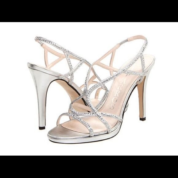 Silver High Heels Silver Metallic High Heels, worn once for prom, good condition Caparros Shoes Heels