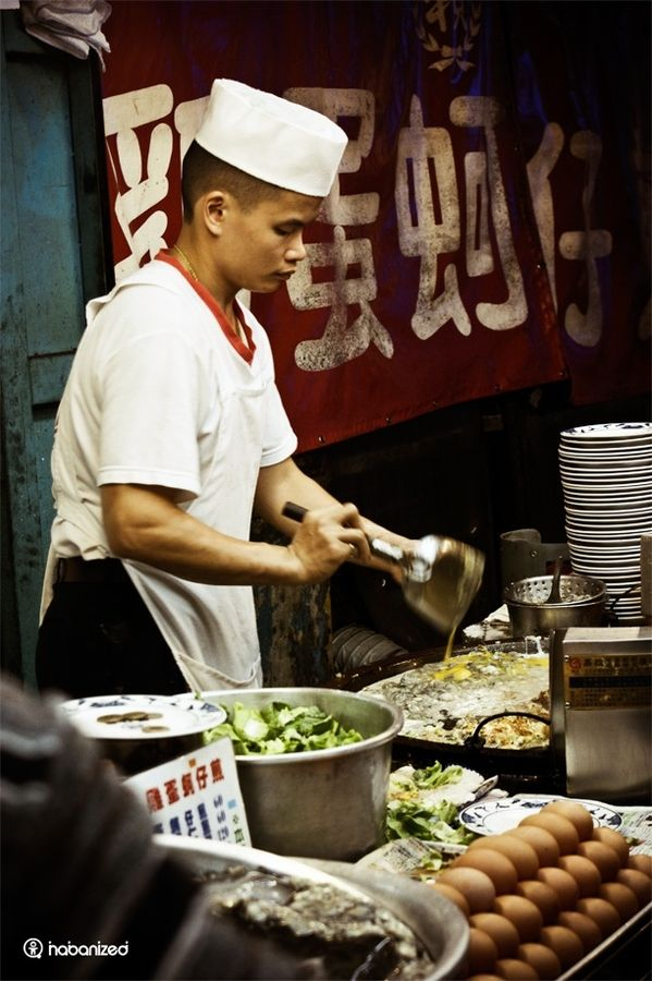 Street chef in Taipei, Taiwan. Find out what else to eat on theculturetrip.com