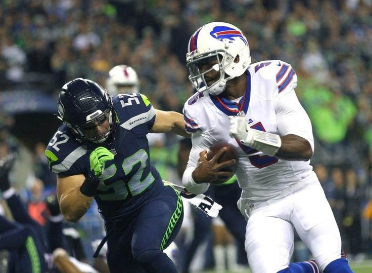 Monday Night Football: Bills vs. Seahawks:   November 7, 2016  - 31-25, Seahawks  -    Buffalo Bills quarterback Tyrod Taylor runs by Seahawks linebacker Brock Coyle to score a touchdown in the first quarter. (Lindsey Wasson / The Seattle Times)