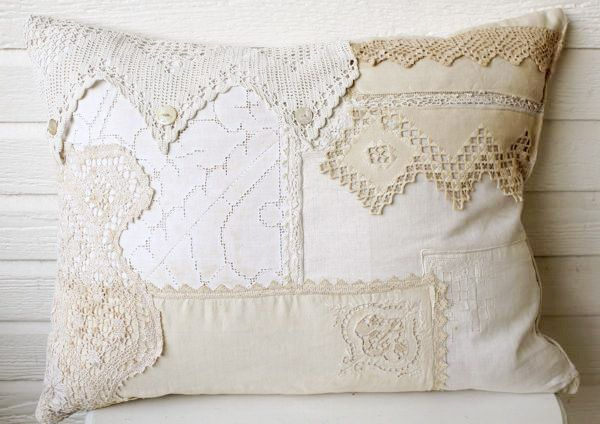 """This is a gorgeous handmade  pillow ~  It has been created with   vintage fabrics, doilies, laces,  handkerchiefs and buttons ~  It measures 19 x 26 inches ~    """"created by Bountiful"""""""