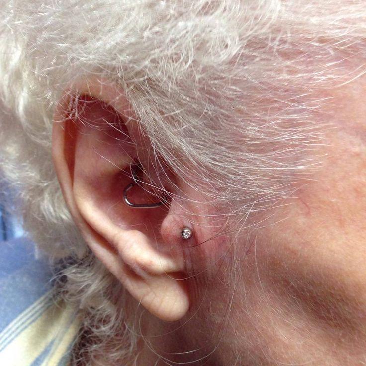 Fresh tragus piercing by Sophie