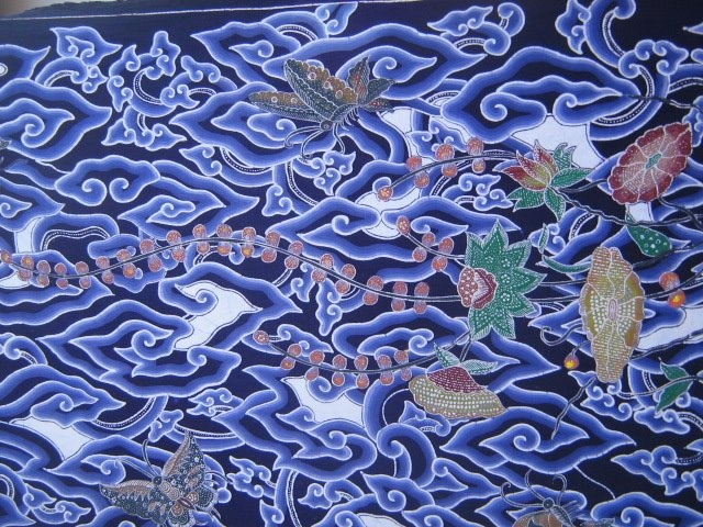 Cirebon Batik is Pesisir batik. Also known as Trusmi Batik because that is the primary production area. The most well known Cirebon batik motif is megamendung (rain cloud) that was used in the former Cirebon Kraton. This cloud motif shows Chinese influence.