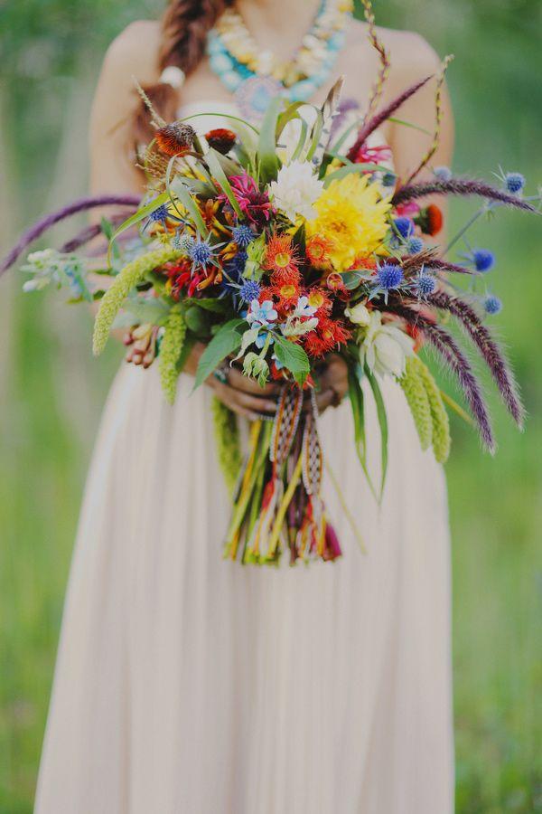 bridal bouquet with blue thistle, rattail status, dahlias, eucalyptus blooms, millet, kangaroo paw.