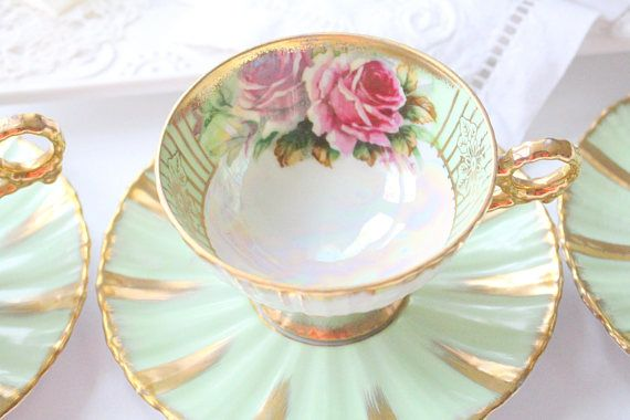 With its distinctive rose motif in the center of the cup, our duo is sure to bring a smile to your face. Gracefully finished on a white and sage green porcelain background. Photographs are also part of the description. All photos are taken in natural light to get the most accurate representation of color. However, please be aware that all computer screens vary due to different monitor calibrations. This listing is for one teacup and saucer. Measures approximately: Cup: 2 7/8 tall x 5 di...