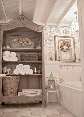 French country armoire with doors removed for easy-access bathroom storage. - perfect for my clients who have a large bathroom!