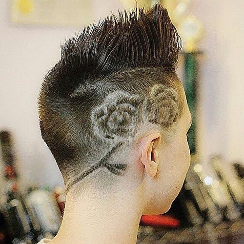women's fauxhawk with side shaved design                                                                                                                                                      More