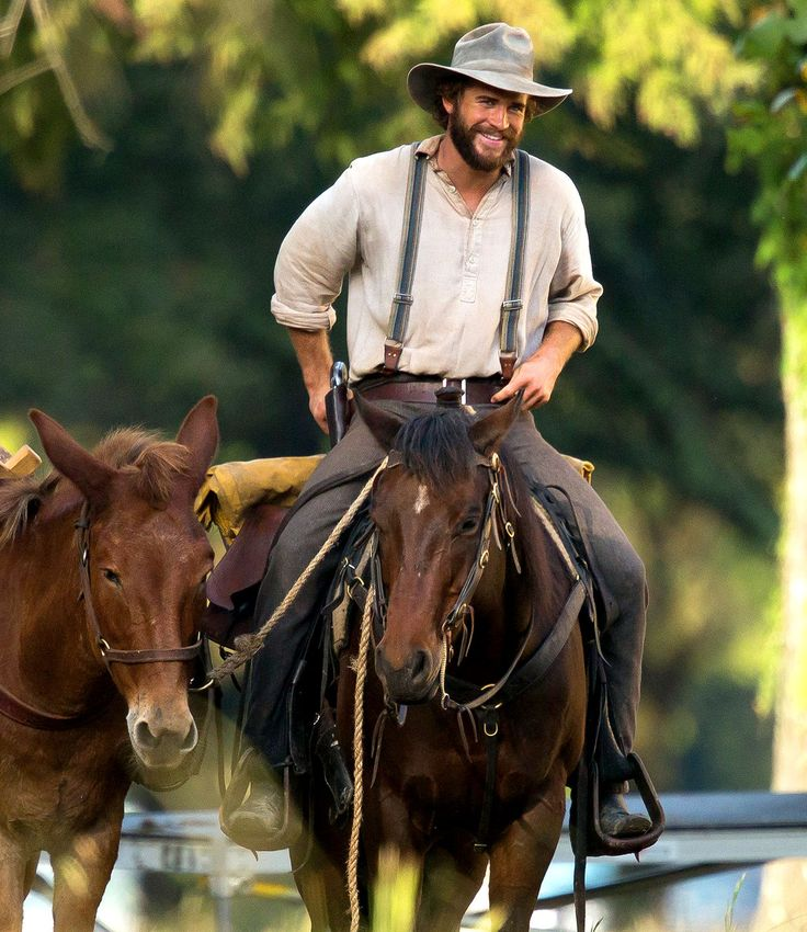 Liam Hemsworth looked hunkier than ever while shooting new Western flick By Way of Helena -- see the horseback riding pictures here.