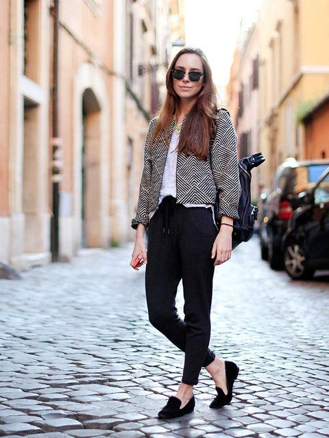 Marina Sidorich, 21, Student.RayBan glasses, Monki jacket, H&M t-shirt, Urban Outfitters trousers, Tiger of Sweden shoes.  More streetstyle inspiration:   Milan Fashion Week street style  Paris Fashion Week street style  London Fashion Week street style  New York Fashion Week street style