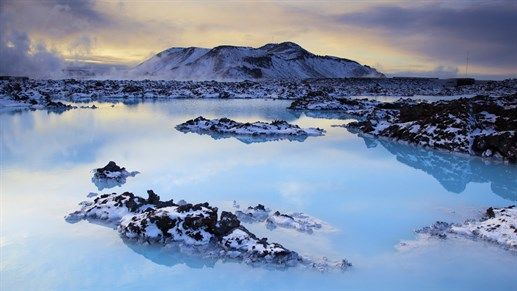 Hidden gems of Europe: Jökulsárlón in Iceland. The black beach combined with the blue colors of the lagoon and the ice blocks floating in it makes for fantastic photo opportunities. #inspiration #travel #kilroy
