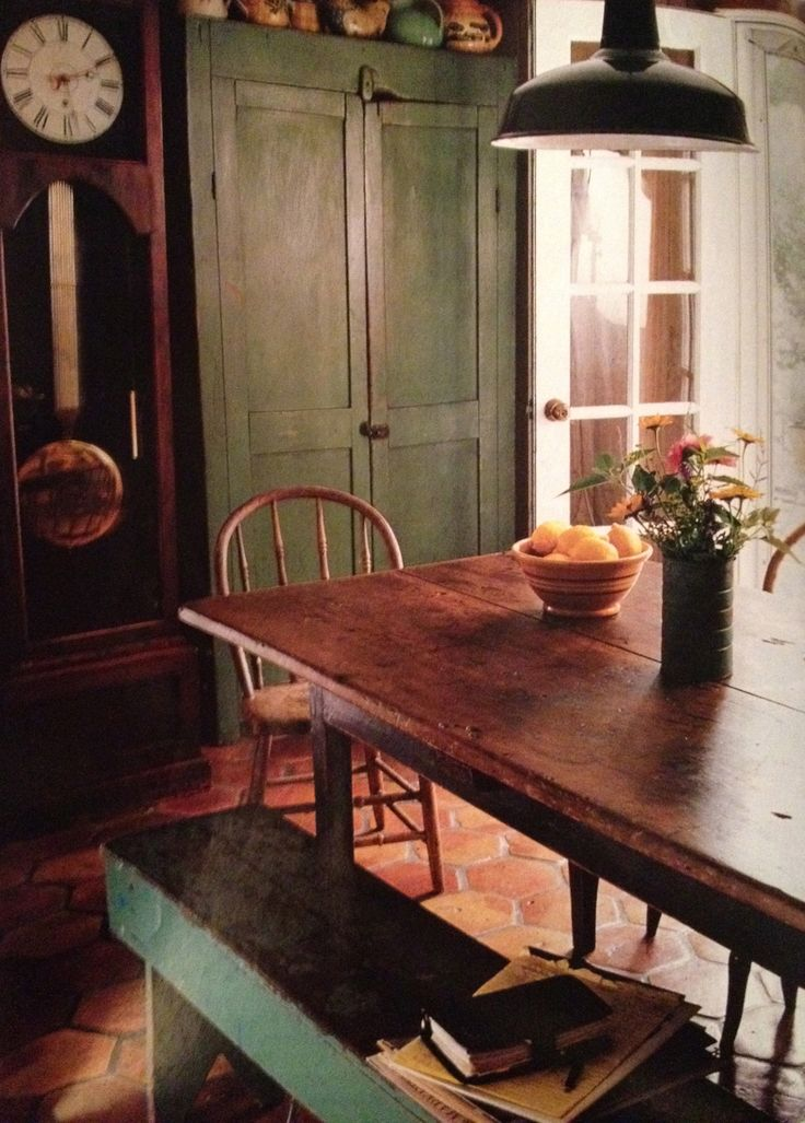 The bench at the dining room table reminds me of my grandmother's kitchen.  Those benches are real handy for lots of things.