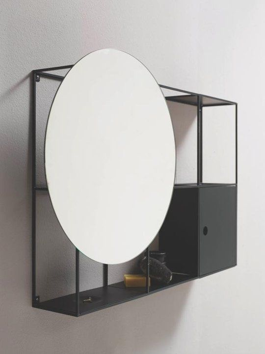 Or mount the mirror to the front of a shelf. This is a pre-made piece from Norm Architects and retailer Ex-t (spotted on Dezeen), but it's easily DIY'able. (It reminds me of decorators who mount framed artwork right to the front of their bookshelves.)