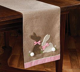 """Linen bunny table runner with pink and white plaid gingham trim and white pom pom bunny tails. 13 1/2""""W X 71 1/2""""D"""