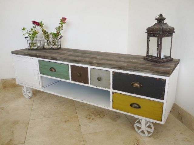 This large wooden industrial style painted TV stand on wheels is a cart that is perfect for your flat screened TV.