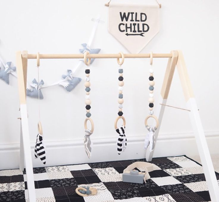 Toy idea for wooden diy playgym. Like the bunny fabric tethers on the end