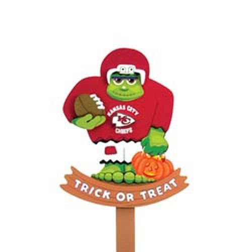 Kansas City Chiefs Halloween Yard Stake by Fans With Pride. $14.95. Features your favorite team's logo and colors. 30 inches tall. A unique Halloween decoration. Show your team spirit this Halloween with a friendly hand-painted monster lawn stake. Each wooden yard stake is represented with official team colors and logos.