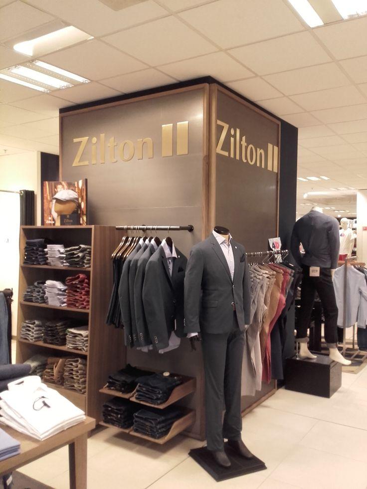 afwerking shop in shop Zilton met uitgelaserde messing logo's