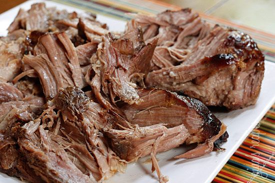 Kalua Pork - Slow Cooker - This is a simple way of making traditional Hawaiian kalua pig without having to dig a hole in your back yard.  This recipe is popular in Hawaii. It is delicious, easy to make and everyone loves it. Serve it on top of a bed of rice.