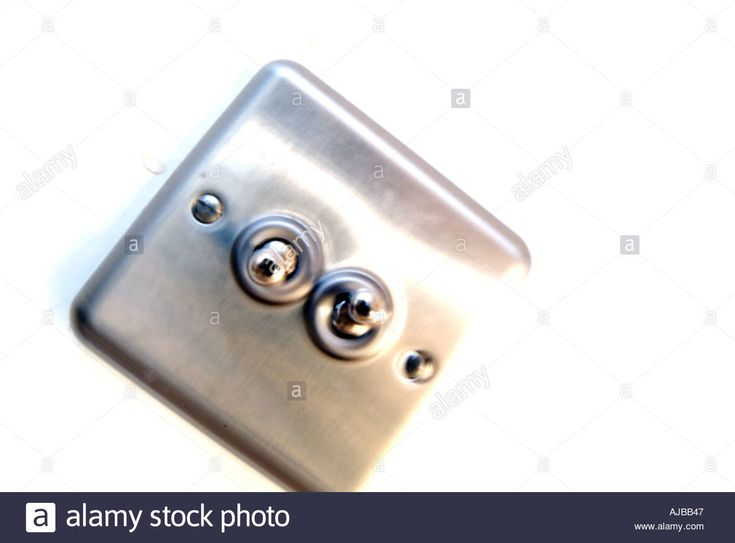 Download this stock image: light switch on off electric light power flick metal click electric - AJBB47 from Alamy's library of millions of high resolution stock photos, illustrations and vectors.