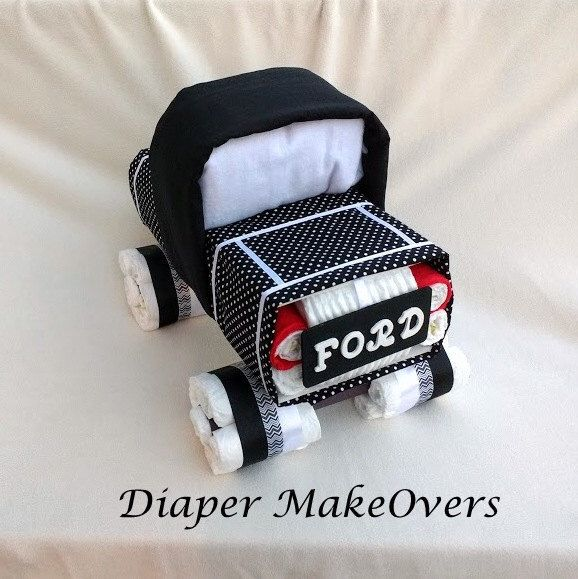 Truck Diaper Cake - Baby Boy Diaper Cake - Unique Diaper Cake - Baby Shower Gift or Centerpiece - OOAK Gift Ideas by DiaperMakeOvers on Etsy https://www.etsy.com/listing/270555116/truck-diaper-cake-baby-boy-diaper-cake