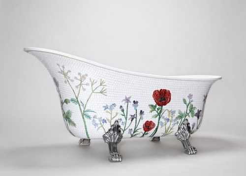 Bathtub with lion's feet and hand-applied floral mosaic ~  mosaic tiles designed by Emelie Solklippa and Hanna Westin-Skogh (Mosaic Sweden  http://www.mosaicsweden.com/swe/hem.php)