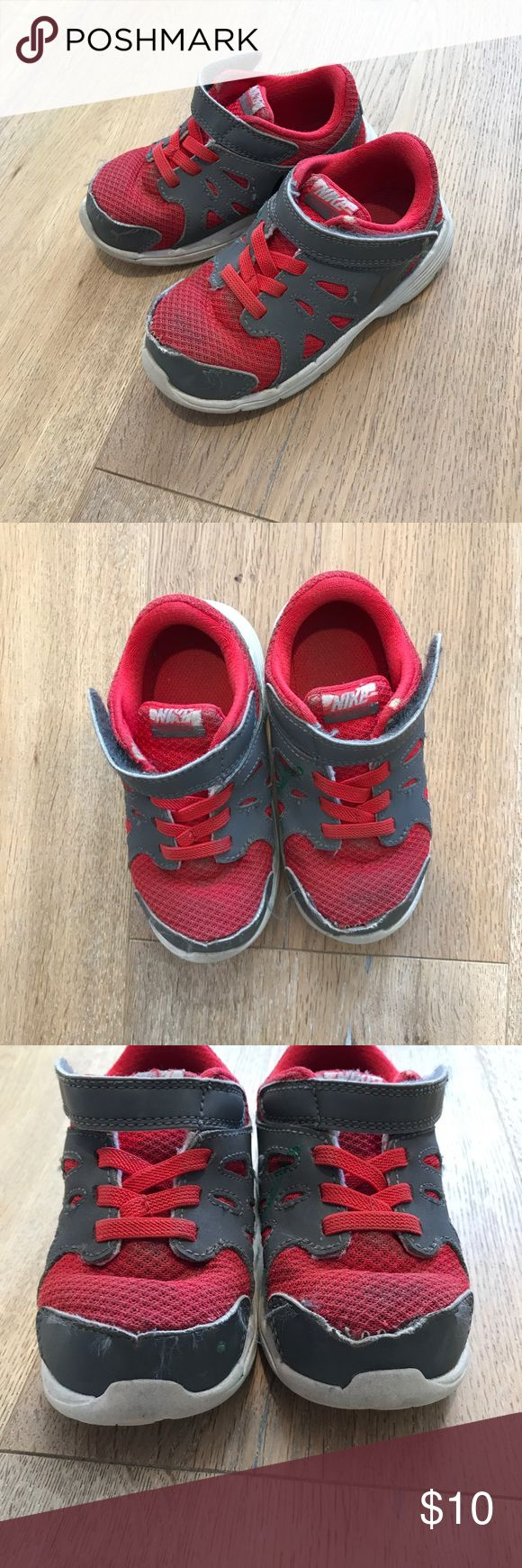 Nike Revolution 2 toddler running Shoes Red and grey Nike sneakers.  No laces to tie!  Just pull on and fasten with Velcro strap.  Play condition for Overall wear.  Still life left!  Size 8c. Nike Shoes Sneakers