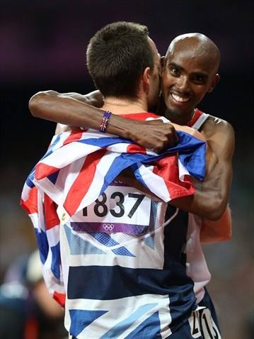 Mohamed Farah of Great Britain celebrates winning gold in men's 10,000m Final with Christopher Thompson of Great Britain on Day 8 of the London 2012 Olympic Games at the Olympic Stadium.