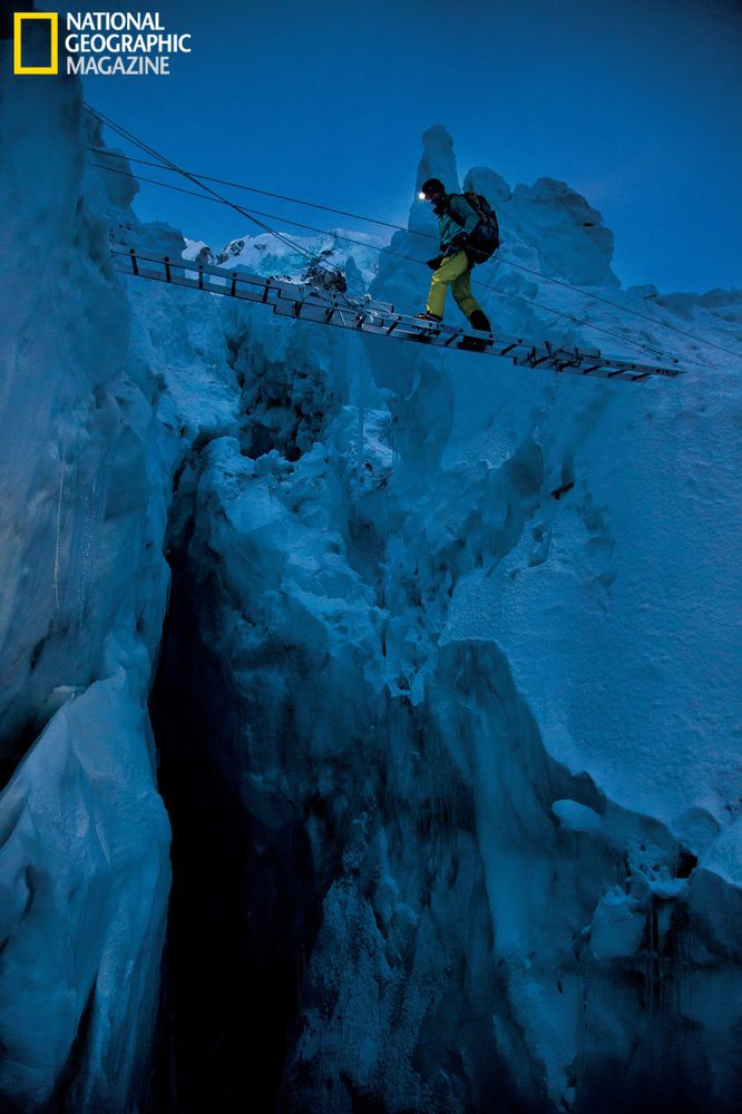 A bridge of aluminum ladders lashed together above a crevasse in the Khumbu Icefall