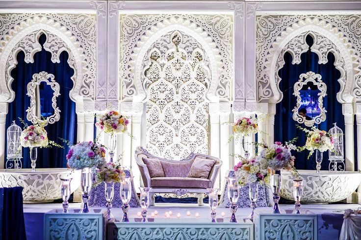 Modern Moroccan inspired Design with Lush florals. Baroque inspired mirror frames.