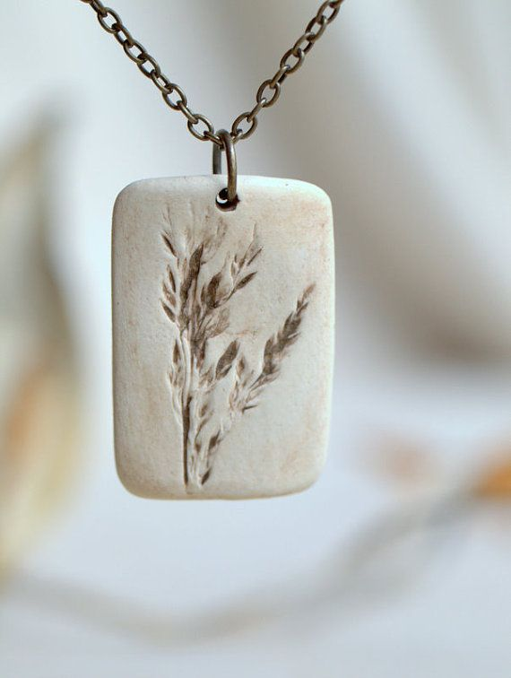 Pride - a sweet porcelain pendant with impression of tiny grass plumes.