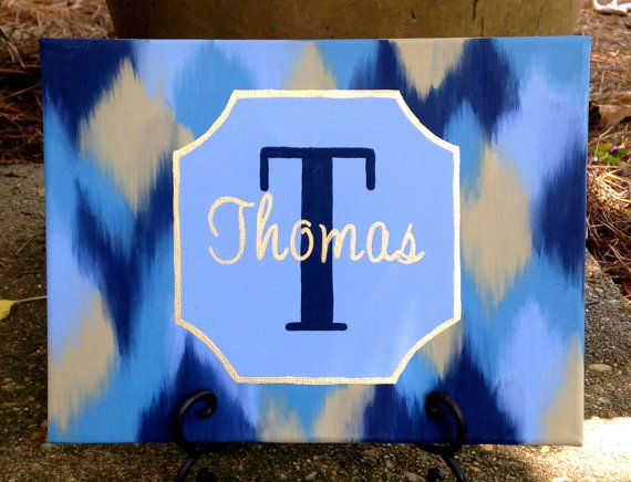 Monogram Canvas with each couple initials on separate solid colored canvases.