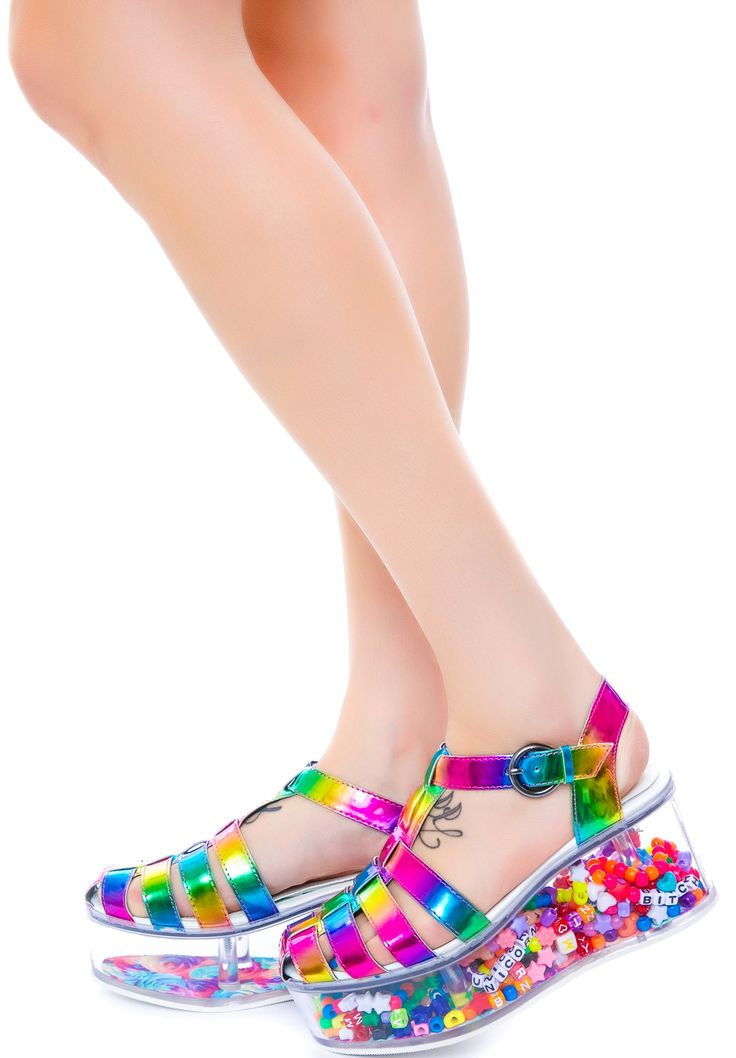 Super fun -- you can open the bottom and fill the heels with anything you like!  Y.R.U. Rainbow Cherii | Dolls Kill