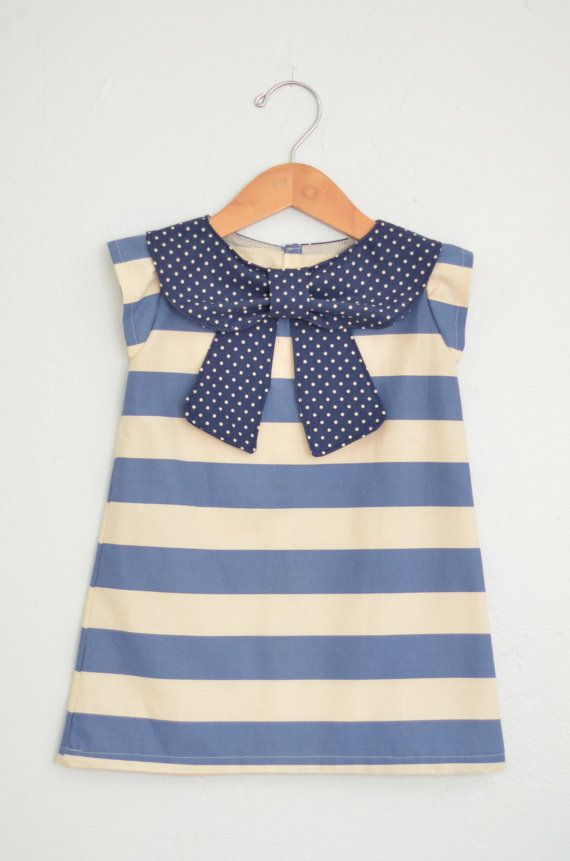 This is a 100% cotton a-line dress with a most adorable collar. It buttons all the way up the back for easy dressing.