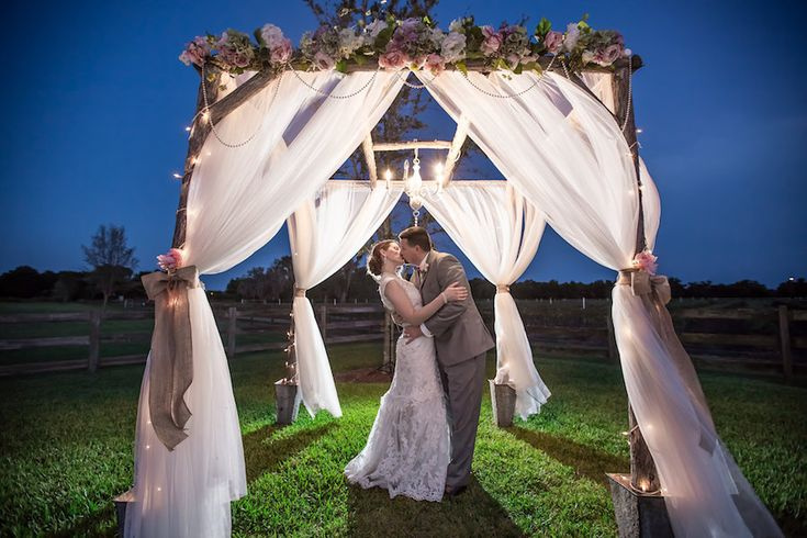 Nighttime, Twilight Bride and Groom Outdoor Wedding Portrait under Wedding Altar | Plant City Wedding Venue Wishing Well Barn | Tampa Wedding Photographer Rad Red Creative