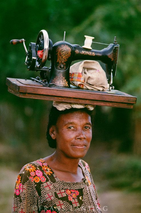 Mahafaly woman carrying sewing machine, Southern Madagascar - I will (try to ) never complain about not having a proper sewing room....and count my blessings. xxxx