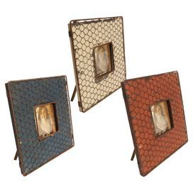 "Set of 3 chicken wire picture frames with wood bases.   Product: 3 Piece frame setConstruction Material: MDF and metal Color: Rust, turquoise and cream Features:  Holds one 4"" x 4"" photo eachDimensions: 9.25"" H x 9.25"" W eachCleaning and Care: Wipe with a soft damp cloth"