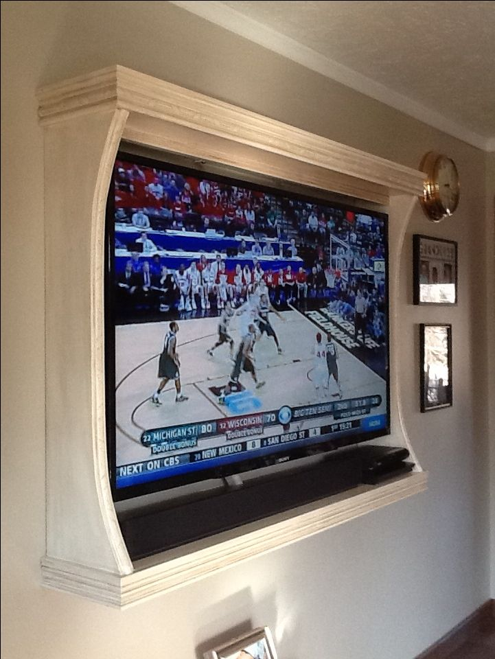 Frame tv on wall.. Love this idea even better, then the kinect can sit on the shelf under the tv, and I can add some lightweight decor to the top shelf.