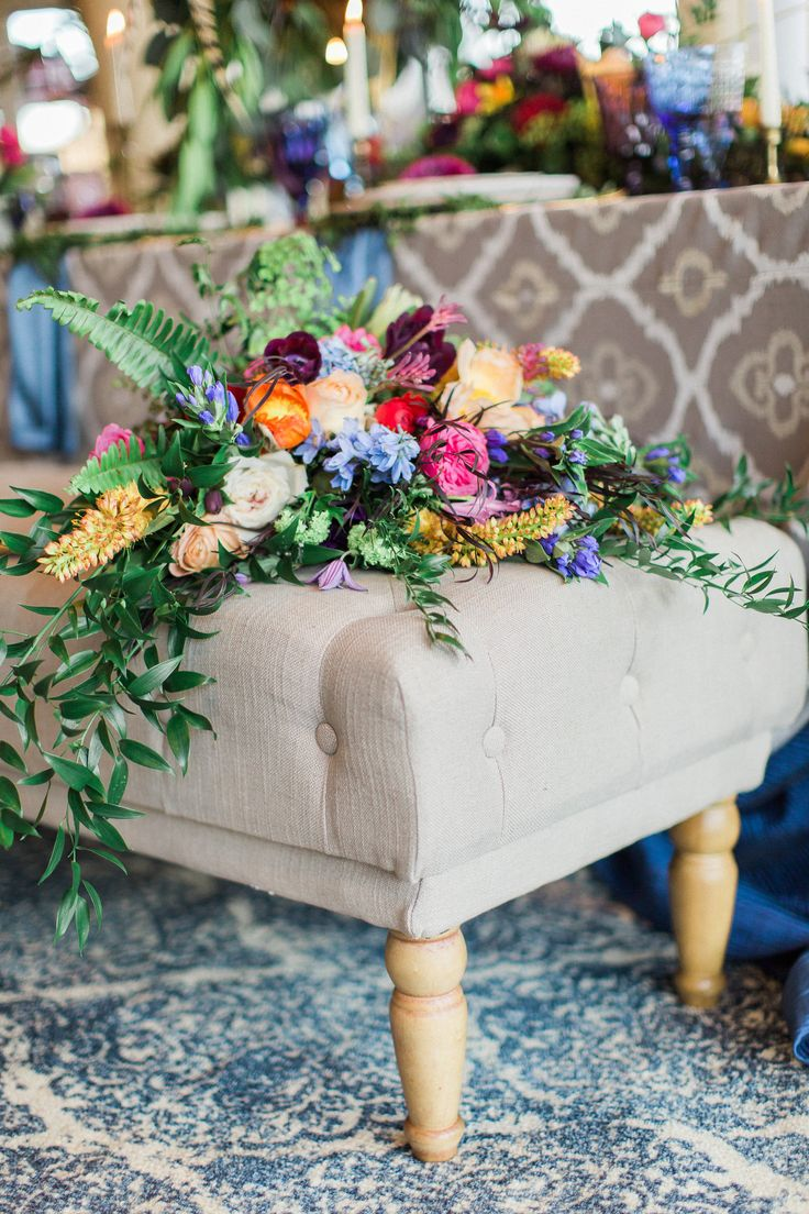 Rich jewel toned flowers on top of our tufted benches.