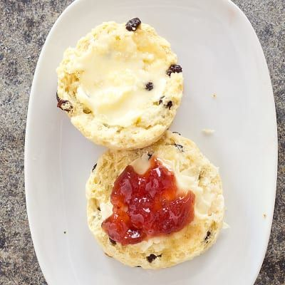 British-Style Currant Scones by Cook's Illustrated -- British scones are not as sweet or as rich as American scones, and that makes them more suitable for serving with butter and jam. To make the lightest, fluffiest scones, we added more than the usual amount of leavening: 2 teaspoons of baking powder per cup of flour.