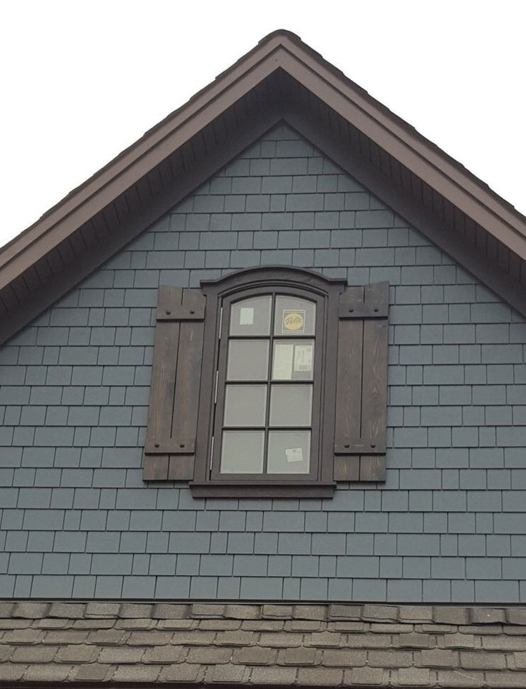 Available cedar shutters with decorative clavos cedar