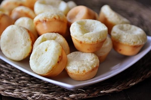 Ingredients:  1 large egg 1/4 cup canola or vegetable or olive oil 2/3 cup milk 1 1/2 cups tapioca flour (fluff the flour before measuring) 3/4 teaspoon salt 1/2 cup packed shredded cheese, like Parmesan or Asiago   Direction:  1. Preheat the oven to 400 degrees F. Lightly grease a mini muffin tin (this makes about 16-24 little breads so if you don't have a muffin tin large enough, you can just make separate batches after the first ones come out).  2. In a blender, combine the egg, oil…