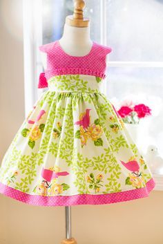 This beautiful handmade classic little girls dress is perfect for many occasions, including Easter, birthday parties and graduation. The dress closes with buttons in the back, includes cap sleeves, an