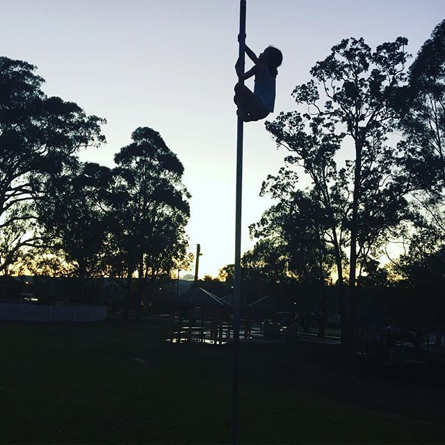 Football goal posts were made for climbing - she's been practicing this for a while and tonight for the first time reached the top. Go miss 7!