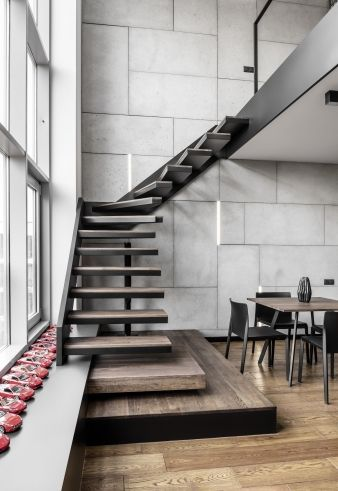 The project features a mezzanine-level work area up the flight of stairs