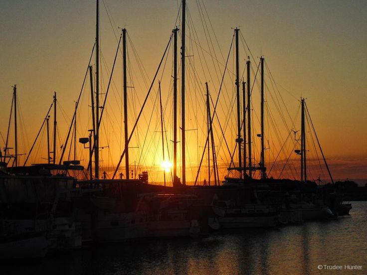 Sunset moorings is a scene captured in Scarborough, Queensland, Australia