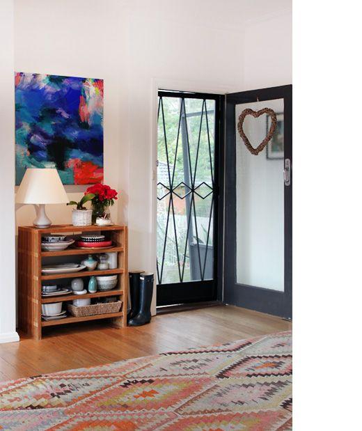 Fab loom rug over boards at door