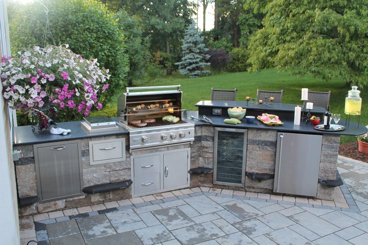 Outdoor kitchen with granite counter tops on paver patio for Outdoor kitchen refrigerators built in
