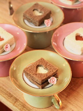 You could serve a little snack with an upside cup and saucer...