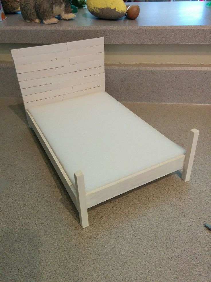 Shiplap Barbie bed!  Headboard made of large popsicle sticks glued to square dowel rods on a basic wood box frame.