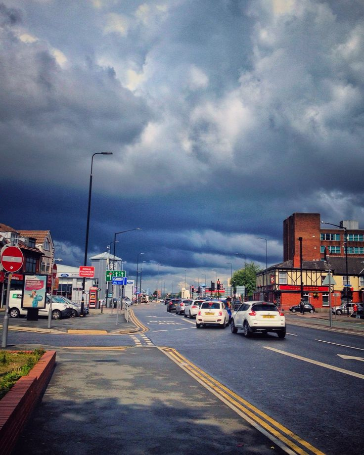 Heavy hearts, like heavy clouds in the sky, are best relieved by the letting of a little water. #clouds #skyline #heavy_clouds #bad_weather_day #rainy_walk #street_photography #rsastreetview  #rsa_streetview #roadside #shops #cars #weather #calm #travelingram #wanderlust #nature #path #explorer #lovely_shot #memoriesframing #photooftheday #momentoftheday #snapseed