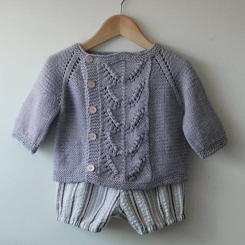 A simple, asymmetrical cardigan with a pretty center panel, Eulalie is knit in one piece from the top down. The simple lace panel with its' oblique arrangement of eyelets and bobbles is echoed in the raglan increases which provide structure to its' sweet shape.